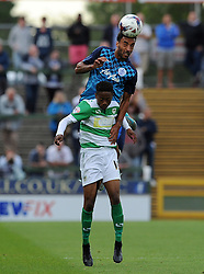 QPR's James Perch challenges for the high ball with Yeovil Town's Iffy Allen - Photo mandatory by-line: Harry Trump/JMP - Mobile: 07966 386802 - 11/08/15 - SPORT - FOOTBALL - Capital One Cup - First Round - Yeovil Town v QPR - Huish Park, Yeovil, England.
