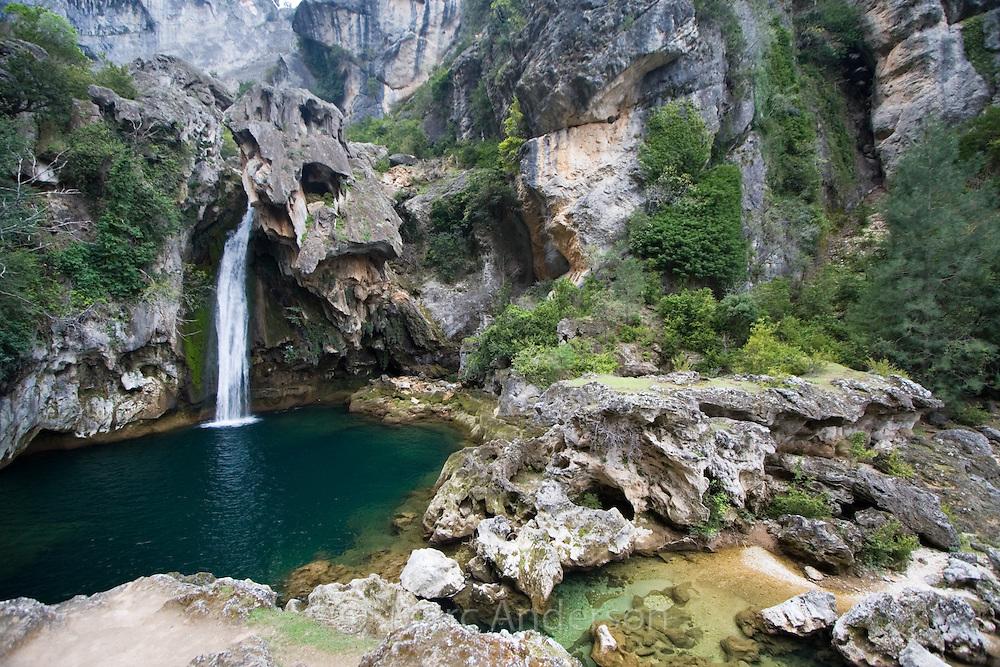 Beautiful waterfall cascading into a blue lagoon, Cazorla National Park, Jaen Province, Andalucia, Spain