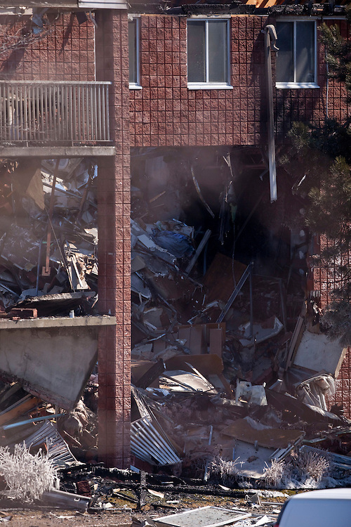 Woodstock, ONT.; March 27, 2011--  The remains of a building in Woodstock, Ontario smoulder after it exploded Sunday  March 27, 2011 sending several people to hospital and leaving nearly 10 unaccounted for.<br /> (GEOFF ROBINS/ Postmedia News)