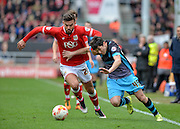 Bristol City midfielder Marlon Pack (21) holds of Sheffield Wednesday striker Fernando Forestieri (45) during the Sky Bet Championship match between Bristol City and Sheffield Wednesday at Ashton Gate, Bristol, England on 9 April 2016. Photo by Adam Rivers.