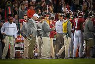 Alabama offensive coordinator Steve Sarkisian, center in red visor.