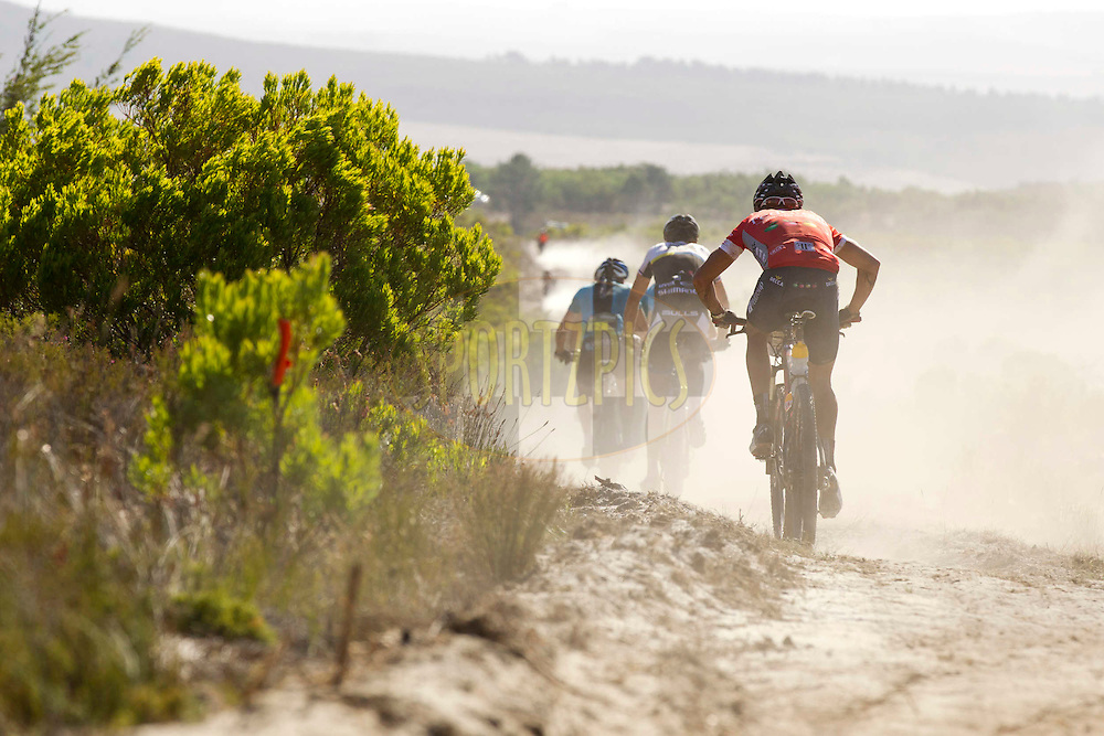CALEDON, 29 March 2012 - Jacques Rossouw of Fedgroup-Itec Connect chases the lead bunch during stage 4 of the 2012 Absa Cape Epic Mountain Bike stage race held at the Overberg Primary & High School in Caledon, South Africa on the 29 March 2012..Photo by Gary Perkin/Cape Epic/SPORTZPICS