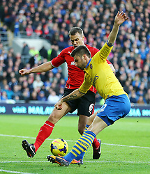 Arsenal's Oliver Giroud is blocked by Cardiff City's Ben Turner - Photo mandatory by-line: Gary Day/JMP - Tel: Mobile: 07966 386802 30/11/2013 - SPORT - Football - Cardiff - Cardiff City Stadium - Cardiff City v Arsenal - Barclays Premier League