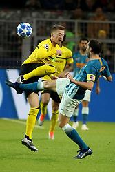 Dortmund, Signal Iduna Park, 24.10.18, Champions League:.Borussia Dortmund - Atletico Madrid..Bild: Im Zweikampf von links Marco Reus (Dortmund) und Diego Godín (Atletico Madrid)......Gemäß den Vorgaben der DFL Deutsche Fußball Liga ist es untersagt, in dem Stadion und/oder vom Spiel angefertigte Fotoaufnahmen in Form von Sequenzbildern und/oder videoähnlichen Fotostrecken zu verwerten bzw. verwerten zu lassen. // DFL regulations prohibit any use of photographs as image sequences and/or quasi-video. (Credit Image: © Joachim Bywaletz/Xinhua via ZUMA Wire)