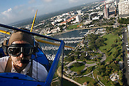 Pilot John Mohr , of St. Paul, Minnesota, flies over downtown St. Petersburg and Demens Landing in his 1943 Stearman bi-plane Friday morning in preparation for the St. Petersburg AirFest at Albert Whitted Airport.  He will perform loops, rolls and other acrobatic stunts over St Petersburg several times times this weekend.  Mohr began flying at age five while sitting in his father's lap.