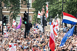 © Licensed to London News Pictures. 09/06/2018. London, UK. 1000s of supporters of EDL founder Tommy Robinson ( real name Stephen Yaxley-Lennon ) demonstrate on Whitehall in Westminster after Robinson was convicted of Contempt of Court . Robinson was already serving a suspended sentence for Contempt of Court over a similar incident , when he was convicted on Friday 25th May 2018 . Photo credit: Joel Goodman/LNP