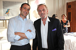 Left to right, BEN GOLDSMITH and MARK SHAND at a party to celebrate the 60th birthday of Mark Shand and the 50th birthday of Tara the elephant held at 29 Portland Place, London on 25th May 2011.