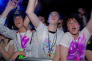 Klaxons' fans with glowsticks rasing their arms, Klaxons gig, february 2007
