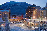Whistler Village sparkles with lights on a winter evening after a fresh snowfall.