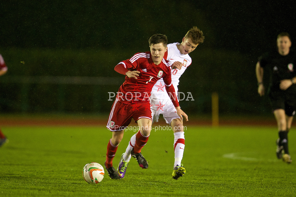 CONNAH'S QUAY, WALES - Thursday, March 20, 2014: Wales' Liam Cullen in action against Poland's Damian Pawlowski during the Under-15's International Friendly match at the Deeside Stadium. (Pic by David Rawcliffe/Propaganda)