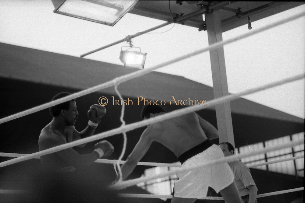 Ali vs Lewis Fight, Croke Park,Dublin.<br /> 1972.<br /> 19.07.1972.<br /> 07.19.1972.<br /> 19th July 1972.<br /> As part of his built up for a World Championship attempt against the current champion, 'Smokin' Joe Frazier,Muhammad Ali fought Al 'Blue' Lewis at Croke Park,Dublin,Ireland. Muhammad Ali won the fight with a TKO when the fight was stopped in the eleventh round.<br /> <br /> Lewis is pictured stumbling backwards as Ali hits out with his left.