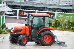 A tractor clears rainwater from the flooded arena  - Team Competition Grade Ib Para Dressage - Alltech FEI World Equestrian Games™ 2014 - Normandy, France.<br /> © Hippo Foto Team - Jon Stroud <br /> 25/06/14