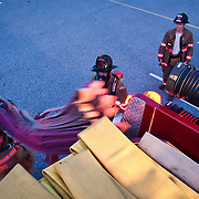 Camden-Wyoming Fire fighters practice hose removal during hose training session Wednesday, July 6, 2011, in Camden-Wyoming Delaware.