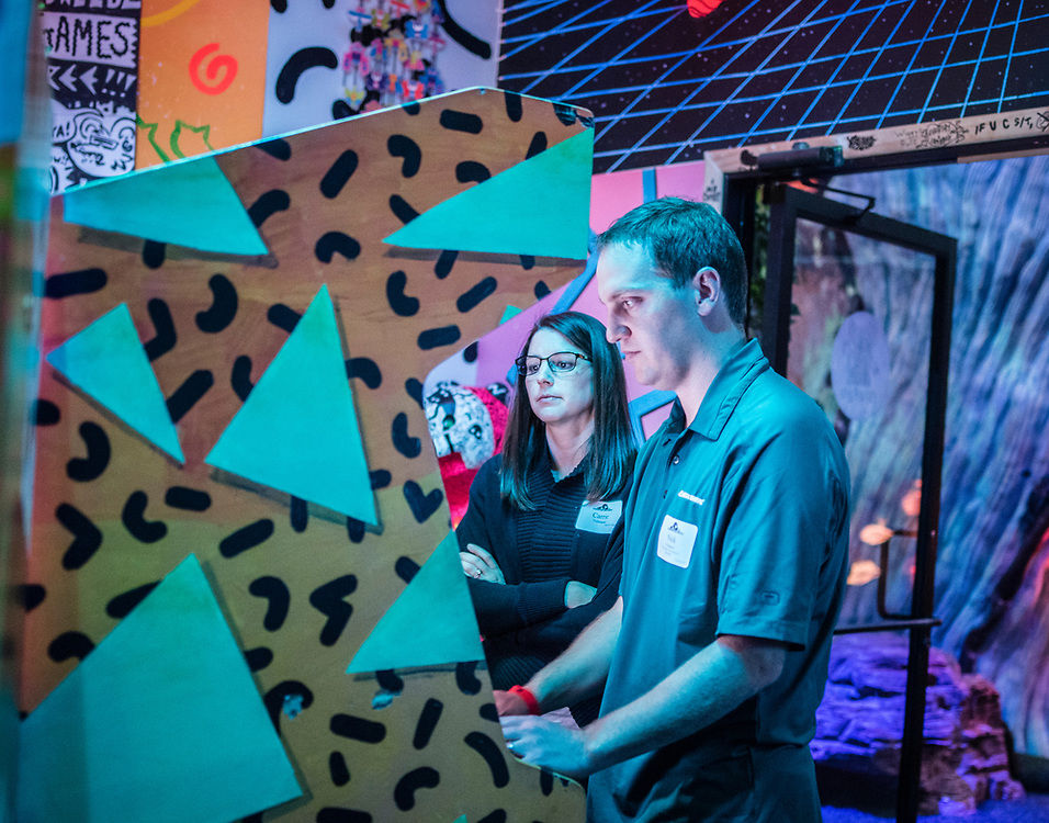 rer040317m/biz/04.03.2017/Roberto E. Rosales <br /> On Friday March 24, 2017 members of Leadership New Mexico visited  Meow Wolf in Santa Fe, New Mexico.  Pictured are Carrie Velasquez(Cq),left, and Nick Velasquez(Cq) who is Director of Sales &amp; Account Management at Delta Dental of New Mexico while playing in the arcade area. <br /> Santa Fe, New Mexico(Roberto E. Rosales/Albuquerque Journal)
