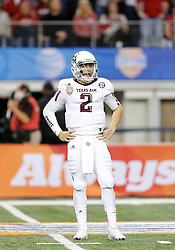 Texas A&M Quarterback Johnny Manziel (2) takes play calls from his sideline during the 77th AT&T Cotton Bowl Classic between the Texas A&M University Aggies and the Oklahoma University Sooners at Cowboys Stadium in Arlington, Texas. Texas A&M wins the 77th AT&T Cotton Bowl Classic against Oklahoma, 41-13.