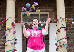 Yarn-bombing during the Scotland-wide World Heritage Day festivities. Six unique events, coordinated by Dig It! 2017, celebrated Scotland's six World Heritage Sites as part of the 2017 Year of History, Heritage and Archaeology. <br /> <br /> Pictured: Bex Smith (who was running the spinning workshops) throwing pom-poms into the air