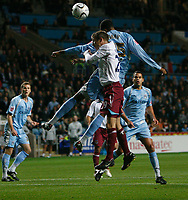Photo: Steve Bond.<br /> Coventry City v West Ham United. Carling Cup. 30/10/2007. Julian Gray (back) gets a header in on goal challanged by  Lee Bowyer