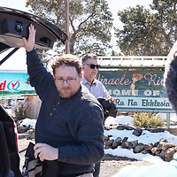Attorney Brendan O'Reilly, left, and Special Master William Sanchez, behind, prepare to walk the Aggressive Christianity Missions Training Corps (ACMTC) compound in Fence Lake Feb. 27th, 2019.