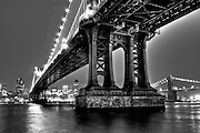 The Manhattan bridge and the Brooklyn Bridge by night seen from the East river bikeway in downtown Manhattan, new york