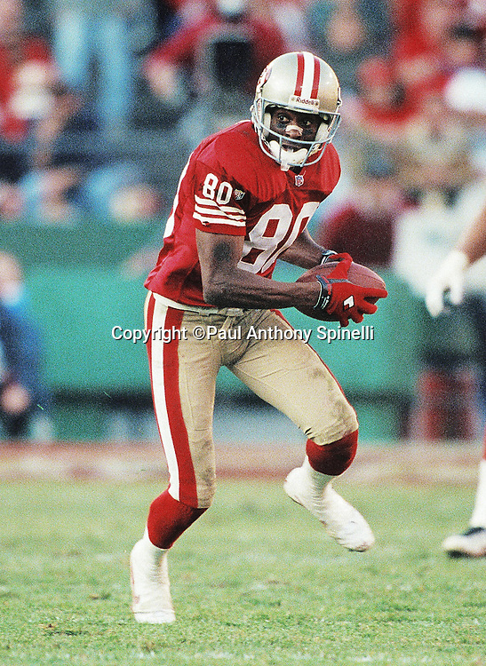 San Francisco 49ers wide receiver Jerry Rice looks for running room after catching a pass during the NFL NFC Divisional Playoff football game against the Green Bay Packers on Jan. 6, 1996 in San Francisco. The Packers won the game 27-17. (©Paul Anthony Spinelli)
