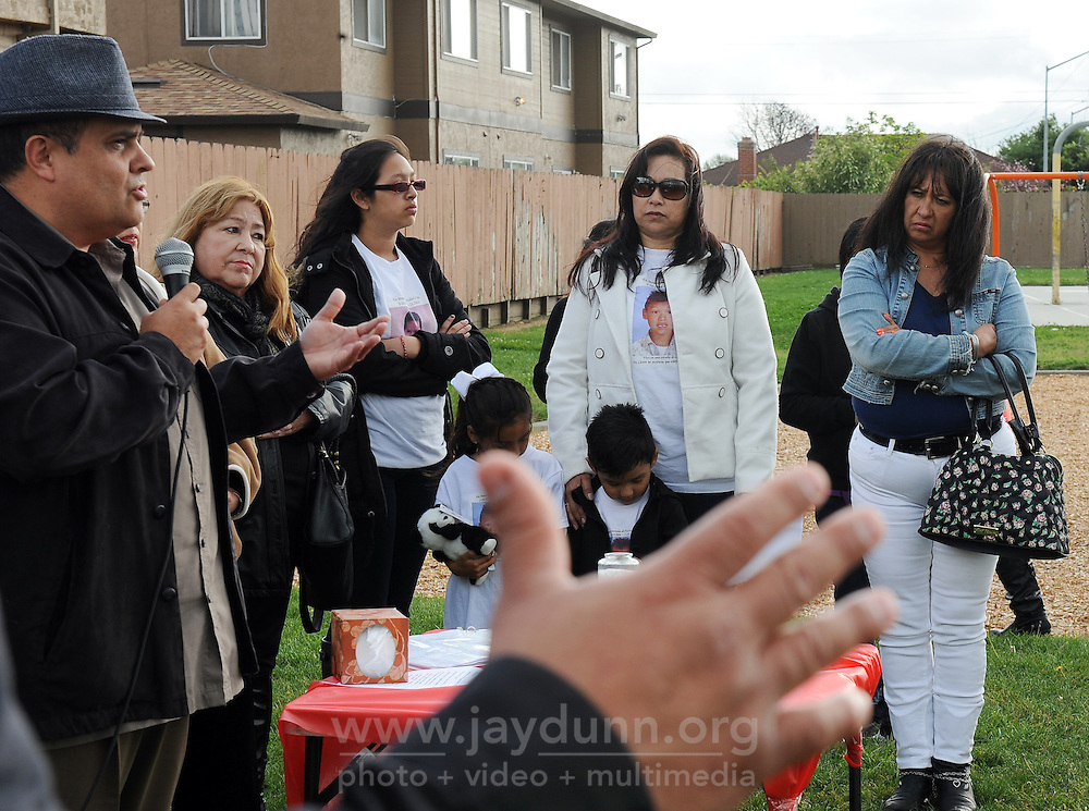 "Maria Alcantar, in white, mother of Azahel Cruz, listens to Pastor Nacho Torres during Sunday's ""100 Mothers Vigil"" in Salinas. Young Azahel, 6-years-old, was struck in the head and killed by a stray bullet during a nearby gang shootout on March 23rd, 2010."