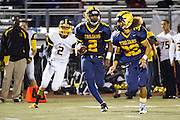Milpitas High School junior, Tre Hartley (2), rushes the football down the field after an interception during the Oct. 5, 2012, home game against Mountain View.  The Trojans would go on to win 42-7.  Photo by Stan Olszewski/SOSKIphoto.