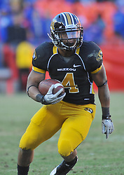 Nov 27, 2010; Kansas City, MO, USA; Missouri Tigers running back Kendial Lawrence (4) runs for yardage in the second half of the game against the Kansas Jayhawks at Arrowhead Stadium. Missouri won 35-7. Mandatory Credit: Denny Medley-US PRESSWIRE