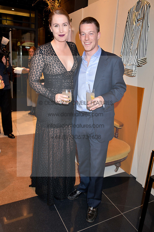 OLIVIA VON HALLE and her husband HUGO VON HALLE at a party to celebrate the launch of Olivia von Halle, 151 Sloane Street, London on 25thNovember 2015