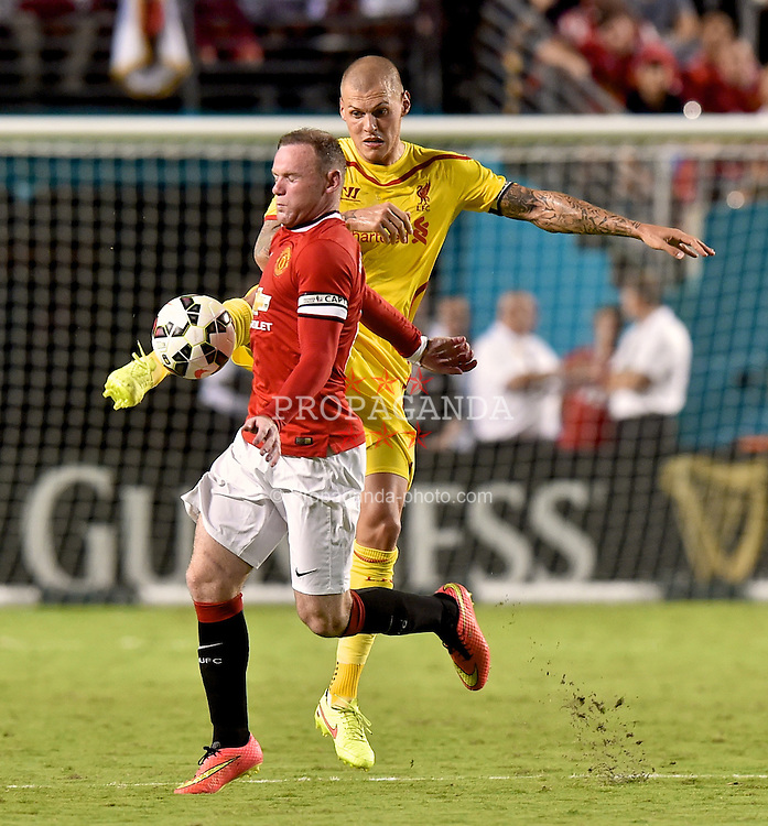 MIAMI, USA - Monday, August 4, 2014: Liverpool's Martin Skrtel in action against Manchester United's Wayne Rooney during the International Champions Cup Final match at the SunLife Stadium on day fifteen of the club's USA Tour. (Pic by David Rawcliffe/Propaganda)