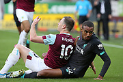 Liverpool defender Joel Matip (32) and Burnley forward Ashley Barnes (10) clash during the Premier League match between Burnley and Liverpool at Turf Moor, Burnley, England on 31 August 2019.