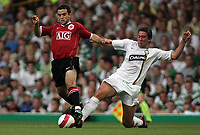 Photo: Paul Thomas.<br /> Glasgow Celtic v Manchester United. Pre Season Friendly. 26/07/2006.<br /> <br /> Manchester's Giuseppe Rossi gets away from Adam Virgo.