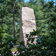 The pink granite monolith pokes through the trees at the Lyndon Baines Johnson Memorial Grove. The memorial is set in Lady Bird Johnson Park on the banks of the Potomac on the George Washington Memorial Parkway in Arlington, Virginia.