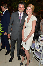 EDWARD TAYLOR and LINN NORSTROM WEILE at a dinner hosted by Cartier in celebration of The Chelsea Flower Show held at The Hurlingham Club, London on 19th May 2014.