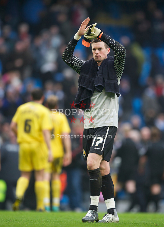 MANCHESTER, ENGLAND - Sunday, February 20, 2011: Notts County's goalkeeper Stuart Nelson applauds the travelling supporters after his side's 5-0 defeat by Manchester City during the FA Cup 4th Round Replay match at the City of Manchester Stadium. (Photo by David Rawcliffe/Propaganda)