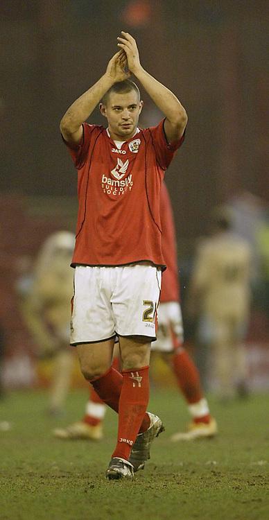 Photo: Aidan Ellis.<br /> Barnsley v Bristol City. Coca Cola League 1. 04/02/2006.<br /> Barnsley's 2 goal hero Marc Richards salutes the fans at the end