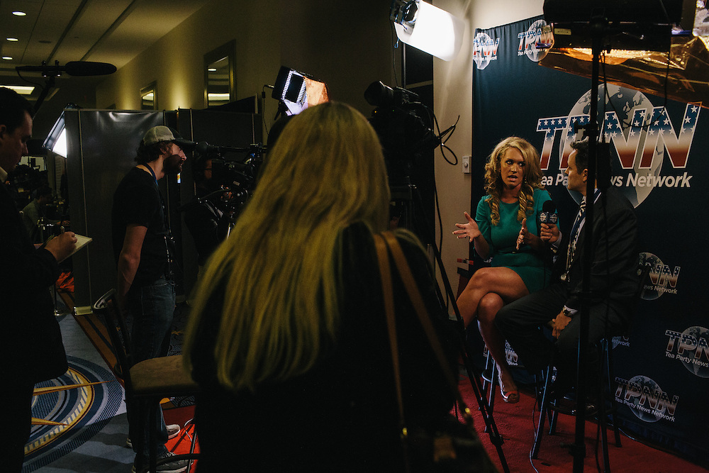 Scottie Hughes, second from right, the news director for the Tea Party News Network speaks on camera for the network during day two of the Conservative Political Action Conference (CPAC) at the Gaylord National Resort & Convention Center in National Harbor, Md.