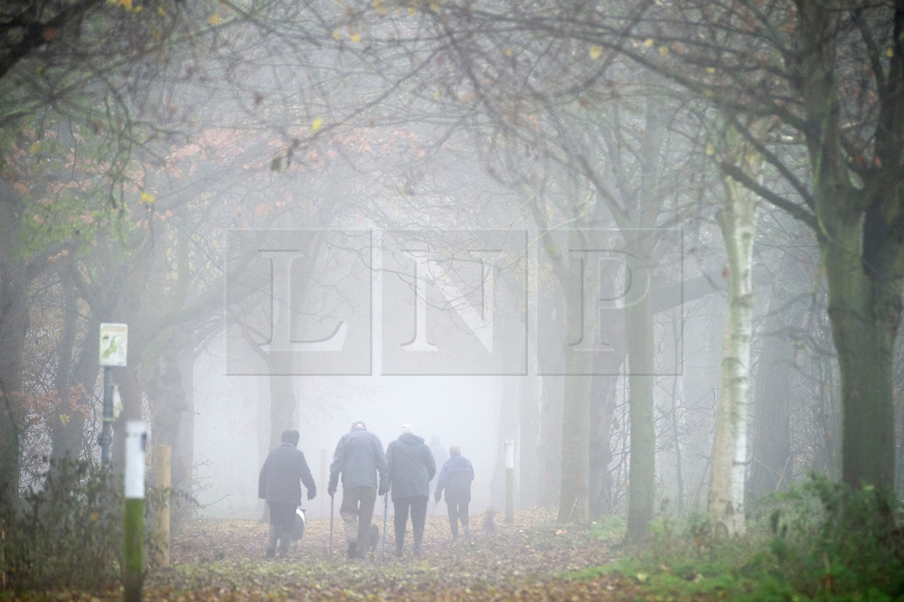 ©Licensed to London News Pictures 30/11/2019.<br /> Sidcup,UK. People out and about in the freezing foggy conditions at Footscray Meadows in Sidcup, South East London this morning. Photo credit: Grant Falvey/LNP