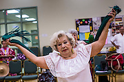 27 JUNE 2012 - GLENDALE, AZ:  BLANCA FERNANDEZ, 80 years old, the coach and choreographer for the Senior FIesta Dancers, works with group during rehearsal at the Glendale Adult Center, in Glendale, AZ, a suburb of Phoenix. Dancing as a part of workout regimen is not unusual, but the Senior Fiesta Dancers use Mexican style folklorico dances for their workouts. The Senior Fiesta Dancers have been performing together for 15 years. They get together every week for rehearsals and perform at nursing homes and retirement centers in the Phoenix area once a month or so. Their energetic Mexican folklorico dances keep them limber and provide a cardio workout.   PHOTO BY JACK KURTZ