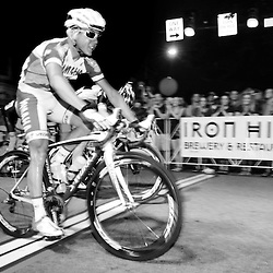 Joseph Schmalz, of Elbowz Racing who won the Pro Men's Iron Hill Twilight Criterium is seen here crossing the finish line in first just a tires lenth ahead of Benjamin Zawacki. TK4