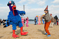 """It was a great day for a couple of dancing """"turkey's"""" at Weirs Beach for the Salvation Army's 6th annual Turkey Plunge on Saturday with  Abilgail Lambert choosing to celebrate her 14th birthday in a special way by raising money for those in need.  (Karen Bobotas/for the Laconia Daily Sun)"""