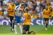 Tranmere Rovers midfielder James Norwood (10) has words with Newport County defender Mark O'Brien (25) during the EFL Sky Bet League 2 Play Off Final match between Newport County and Tranmere Rovers at Wembley Stadium, London, England on 25 May 2019.