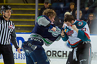 KELOWNA, CANADA - JANUARY 30:  Cade McNelly #3 of the Seattle Thunderbirds drops the gloves with Schael Higson #21 of the Kelowna Rockets on January 30, 2019 at Prospera Place in Kelowna, British Columbia, Canada.  (Photo by Marissa Baecker/Shoot the Breeze)