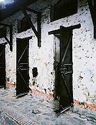 Doors to cells at Bagne 1 prison, built it 1862 by the French to imprison Vietnamese freedom fighters. It was used  (renamed Phu Hai) by the South Vietnamese (and Americans) to jail Viet Cong fighters and supporters.
