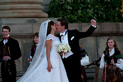 59711933 <br /> The newly wed Swedish Princess Madeleine and U.S. banker Christopher O Neill kiss outside the Royal Chapel after their wedding ceremony in Stockholm, Sweden, on June 8, 2013. UK ONLY