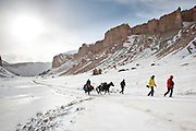 Mike Lebecki, in red, and John Trousdale, in yellow, walk back from Band-e Amir to Koh-e Kanak, while Hussein Dad leads the pack horses.