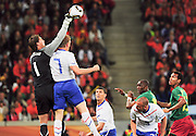 CAPE TOWN, SOUTH AFRICA- Thursday 24 June 2010, Dutch goalkeeper Maarten Stekelenburg puches the ball away during the match between the Netherlands (Holland) and Cameroon held at the new Cape Town Stadium in Green Point during the 2010 FIFA World Cup..Photo by Roger Sedres/Image SA