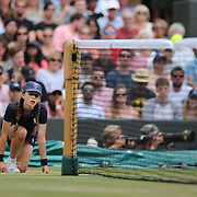 LONDON, ENGLAND - JULY 12:  A ball girl in action on Court One during the Wimbledon Lawn Tennis Championships at the All England Lawn Tennis and Croquet Club at Wimbledon on July 12, 2017 in London, England. (Photo by Tim Clayton/Corbis via Getty Images)