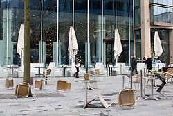 © Licensed to London News Pictures . 22/03/2013 . Manchester , UK . Heavy gusts of wind blow chairs and tables over outside a branch of Pret a Manger in Spinningfields in Manchester this (22nd March) afternoon . Heavy wind , rain and snow across the north of the UK is causing disruption today (22nd March) . Photo credit : Joel Goodman/LNP