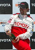 Apr 12, 2003; Long Beach, CA, USA; Actor PETER RECKELL splashes champaigne on the crowd @ the 27th Annual Pro/Celebrity Race in Long Beach racing Toyota Celica race cars.  Driving 10 laps on a 1.97 mile track along shoreline drive.<br />