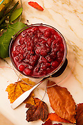 Homemade cranberry sauce for Thankgiving in Florida wih atuumn leaves imported from New York